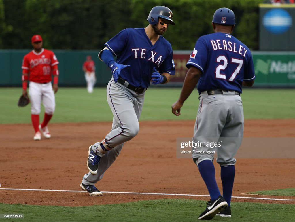 Joey Gallo #13 of the Texas Rangers rounds third base on his way home after hitting a solo homerun during the second inning of the MLB game against the Los Angeles Angels of Anaheim at Angel Stadium of Anaheim on September 17, 2017 in Anaheim, California.