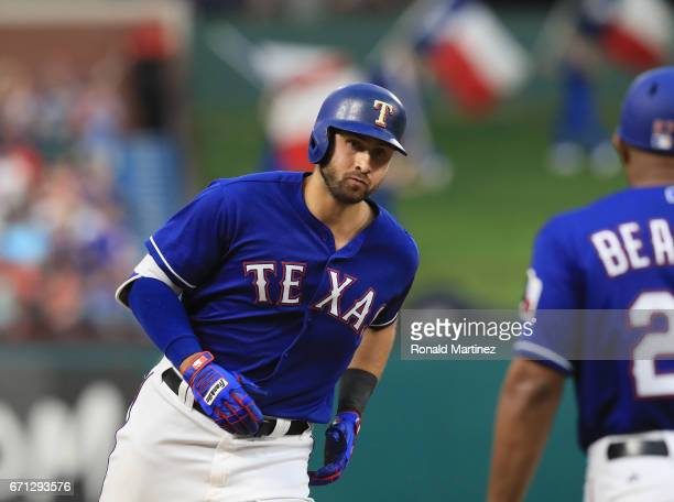 Joey Gallo of the Texas Rangers runs past third base after hitting a tworun home run against the Kansas City Royals in the second inning at Globe...