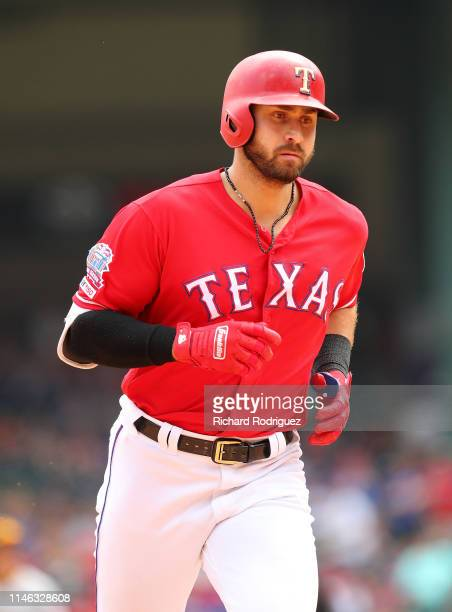 Joey Gallo of the Texas Rangers runs the bases after a solo home run in the sixth inning against the Pittsburgh Pirates at Globe Life Park in...