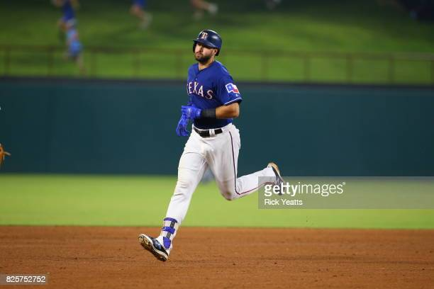 Joey Gallo of the Texas Rangers runs the bases after hitting a solo home run in the fourth inning against the Seattle Mariners at Globe Life Park in...