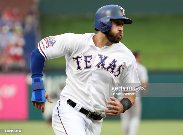Joey Gallo of the Texas Rangers scores a run in the second inning against the St Louis Cardinalsat Globe Life Park in Arlington on May 17 2019 in...