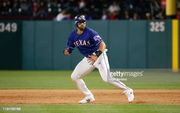 Joey Gallo of the Texas Rangers takes a lead off of first base against the Houston Astros during the eighth inning at Globe Life Park in Arlington on...