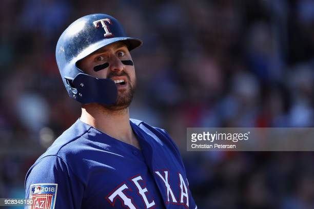 Joey Gallo of the Texas Rangers warms up on deck during the spring training game against the San Francisco Giants at Surprise Stadium on March 5 2018...
