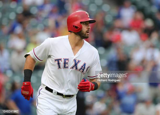 Joey Gallo of the Texas Rangers watches his solo home run shot in the eighth inning of a game against the Seattle Mariners at Globe Life Park in...