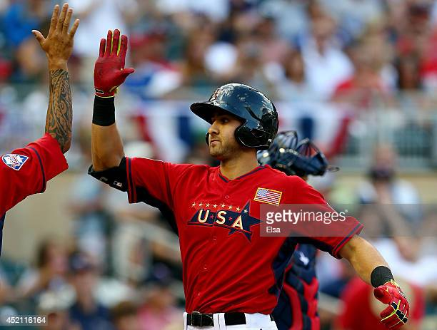 Joey Gallo of the U.S. Team celebrates with J.P. Crawford after hitting a home run against the World Team during the SiriusXM All-Star Futures Game...