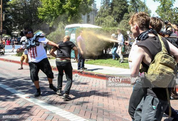Joey Gibson organizer of the altright Patriot Prayer gets pepper sprayed by counter protesters during the No To Marxism rally at Matin Luther King Jr...