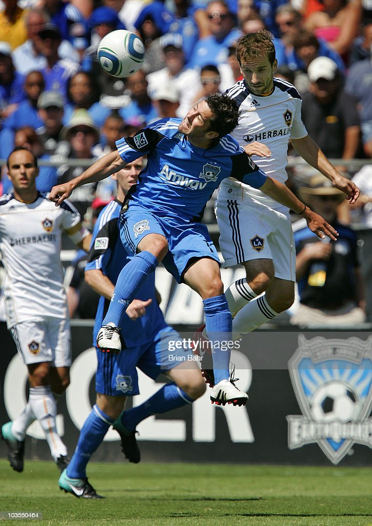 Joey Gjertsen #17 of the San Jose Earthquakes heads the ball away from Mike Magee #18 of the Los Angeles Galaxy on August 21, 2010 at Buck Shaw Stadium in Santa Clara, California. The Earthquakes won 1-0.