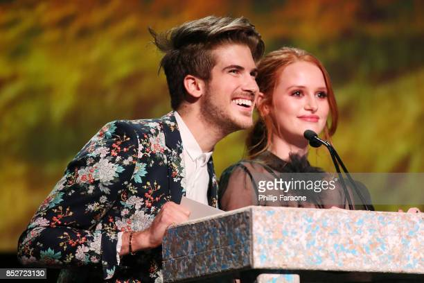 Joey Graceffa and Madelaine Petsch speak onstage at the Environmental Media Association's 27th Annual EMA Awards at Barkar Hangar on September 23...