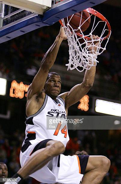 Joey Graham of the Oklahoma State Cowboys dunks the ball in the second half against the Colorado Buffaloes in Day 2 of the Phillips 66 Big 12 Men's...