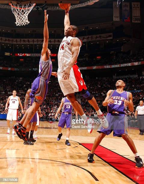 Joey Graham of the Toronto Raptors drives to the net for a dunk overtop of Shawn Marion of the Phoenix Suns on December 5 2007 at the Air Canada...