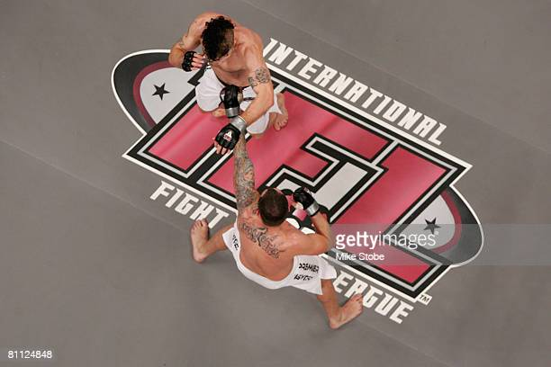 Joey Guel receives a punch from Matt Horwich of the Team Quest Fight club during their bout presented by the International Fighting League at the...