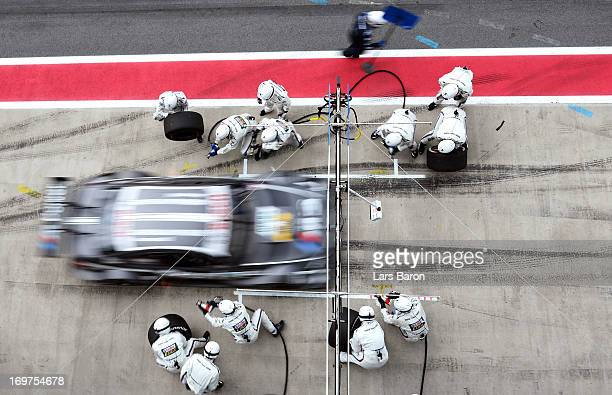 Joey Hand of USA and BMW Team RBM makes a pit stop during the training session for the third round of the DTM 2013 German Touring Car Championship at...