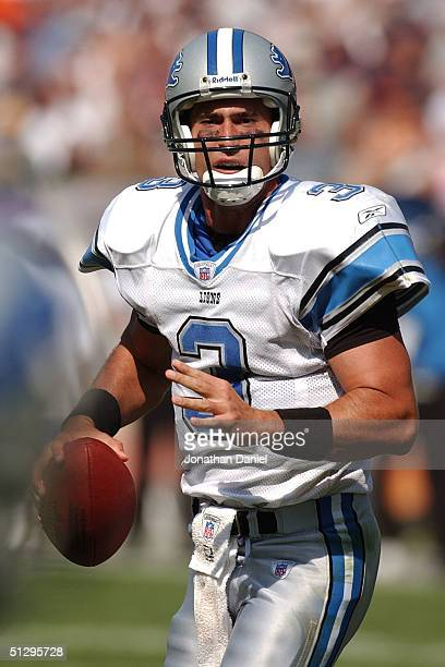 Joey Harrington of the Detroit Lions looks for a receiver in the end zone during a game against the Chicago Bears on September 12 2004 at Soldier...