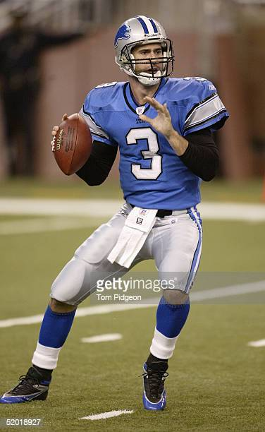 Joey Harrington of the Detroit Lions sets to pass during the game against the Arizona Cardinals at Ford Field on December 5 2004 in Detroit Michigan...