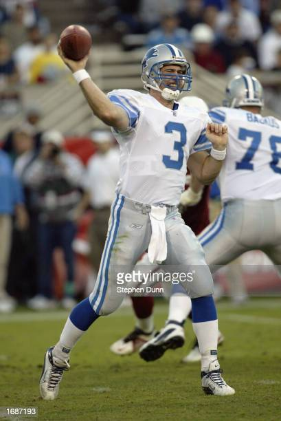 Joey Harrington of the Detroit Lions throws a pass versus the Arizona Cardinals while offensive tackle Jeff Backus blocks on December 8 2002 at Sun...