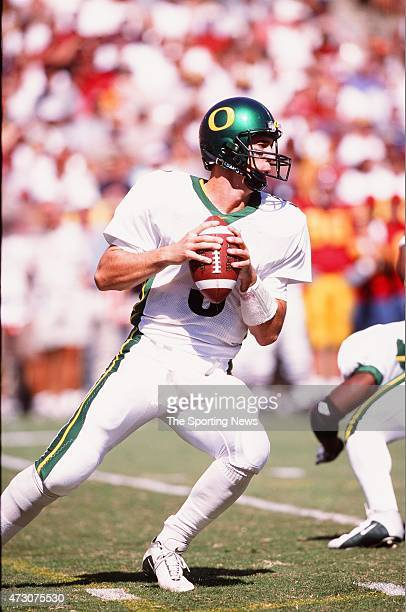 Joey Harrington of the Oregon Ducks drops back to pass against the USC Trojans on October 14 2000