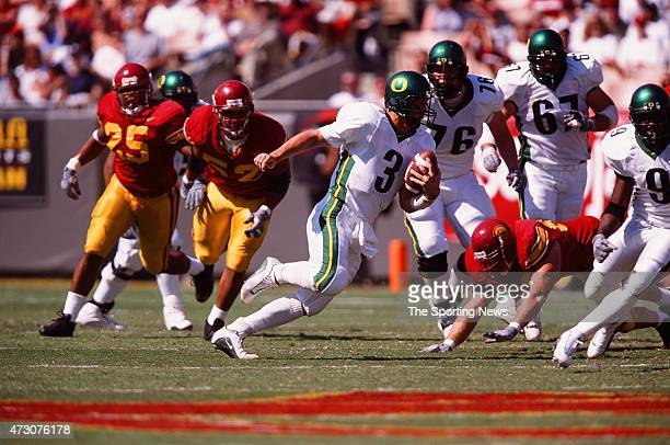 Joey Harrington of the Oregon Ducks runs with the ball against the USC Trojans on October 14 2000
