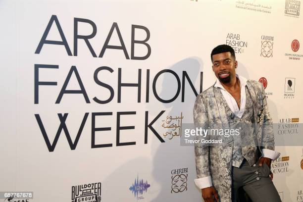 Joey Harris poses at the Arab Fashion Week Ready Couture Resort 2018 Gala Dinner on May 202017 at Armani Hotel in Dubai United Arab Emirates
