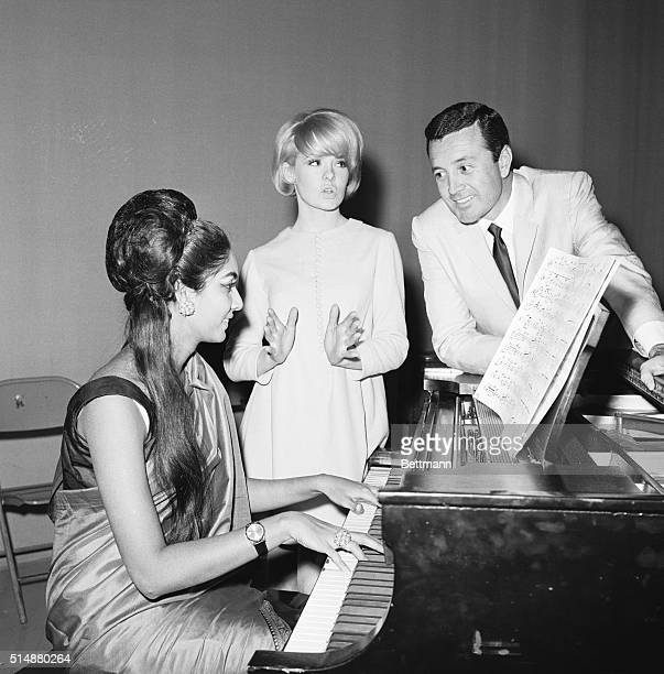 Joey Heatherton and Vic Damone rehearse a song with Reita Faria, Miss World 1966, of Bombay, India, for Bob Hope's Christmas tour of U.S. Military...