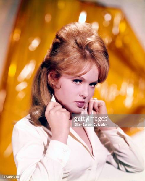 Joey Heatherton US actress dancer and singer poses holding the collar of her white blouse circa 1965