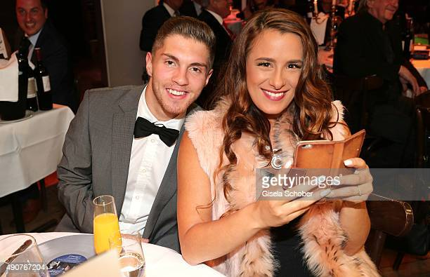 Joey Heindle and his girlfriend Justine Dippl during Ralph Siegel's 70th birthday party at Schuhbeck's Teatro on September 30 2015 in Munich Germany