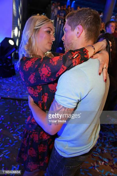 Joey Heindle and his girlfriend Ramona Elsener attend the Promi Big Brother final at MMC Studios on August 23 2019 in Cologne Germany