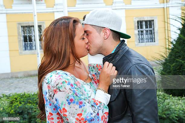 Joey Heindle kisses his girlfriend Justine Dippl during a photo session at the Stockerauer Stadtfest on August 30 2014 in Stockerau Austria