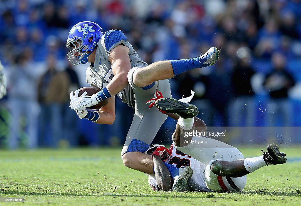 Joey Herrick #87 of the Kentucky Wildcats is tackled by Corey Moore #39 of the Georgia Bulldogs at Commonwealth Stadium on November 8, 2014 in Lexington, Kentucky.