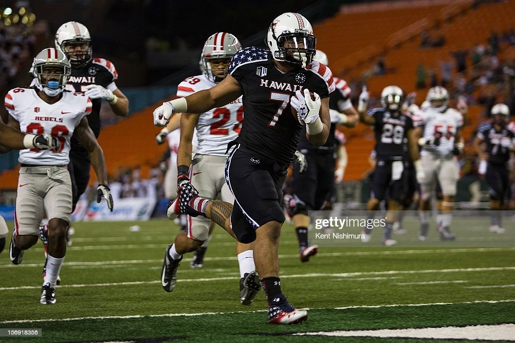 Joey Iosefa #7 of the Hawaii Warriors carries the ball into the end zone for a touchdown during a NCAA college football game between the UNLV Rebels and the Hawaii Warriors on November 24, 2012 at Aloha Stadium in Honolulu, Hawaii.