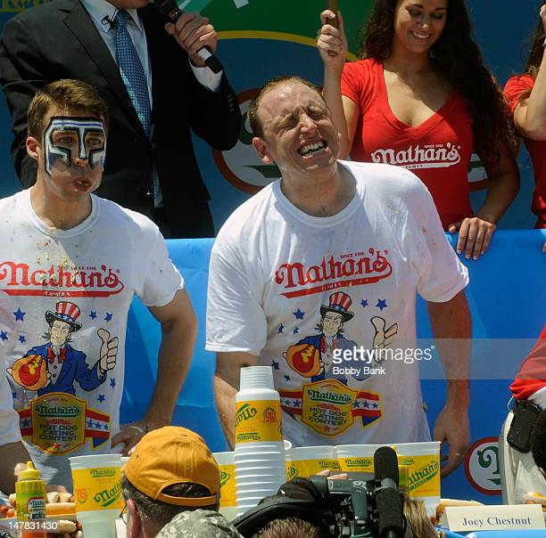 Joey 'Jaws' Chestnut and Tim 'Eater X' Janus compete in the 2012 Mens Competition at the 2012 Nathan's Famous Fourth Of July International Hot Dog...