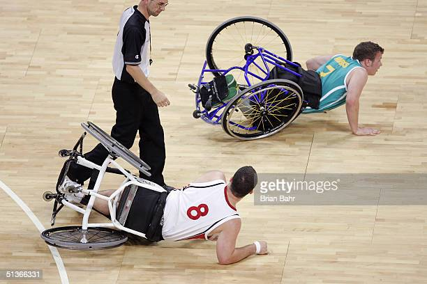 Joey Johnson of Canada and Shaun Norris of Australia both end up on the floor in a physical game for the gold medal in wheelchair basketball on...