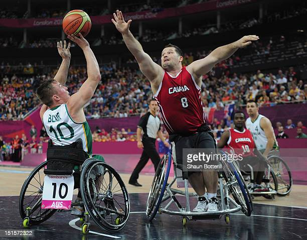 Joey Johnson of Canada challenges Jannik Blair of Australia during the gold medal Wheelchair Basketball match between Australia and Canada on day 10...