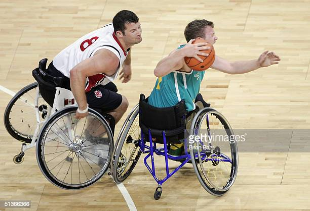Joey Johnson of Canada collides with Shaun Norris of Australia sending both to the floor in a physical game for the gold medal in wheelchair...