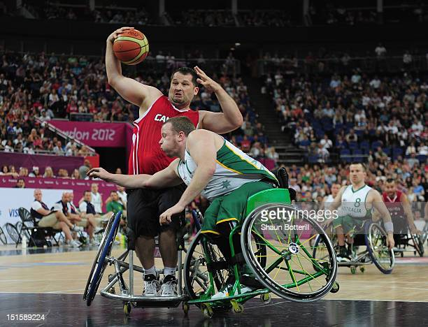 Joey Johnson of Canada is challenged Shaun Norris of Australia during the gold medal Wheelchair Basketball match between Australia and Canada on day...