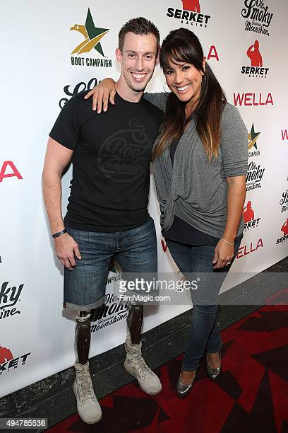 Joey Jones and Leeann Tweeden attend the Boot Campaign's Comedy Boot Jam at The Improv on October 28 2015 in Hollywood California