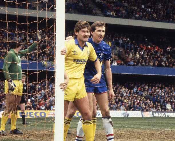 Joey Jones of Chelsea marks former Chelsea player Chris Hutchings during the English Division Two match between Chelsea and Brighton & Hove Albion...