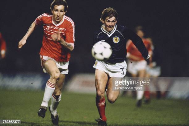 Joey Jones of Wales and Kenny Dalglish of Scotland pictured in action running for the ball during the British Championships home international match...