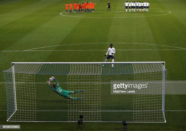 Joey Koorevaar of the Netherlands saves a penalty from Folarin Balogun of England to win the match during the UEFA European Under-17 Championship...
