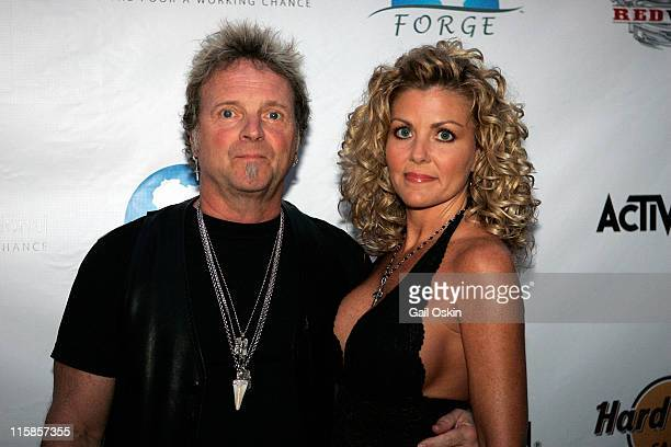 Joey Kramer drummer for Boston rock band Aerosmith and girlfriend Linda attend the Guitar Hero Aerosmith event at the Hard Rock Cafe on August 25...