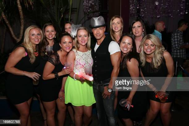 Joey Lawrence poses with fans while hosting The Pool After Dark at Harrah's Resort on Saturday June 1 2013 in Atlantic City New Jersey