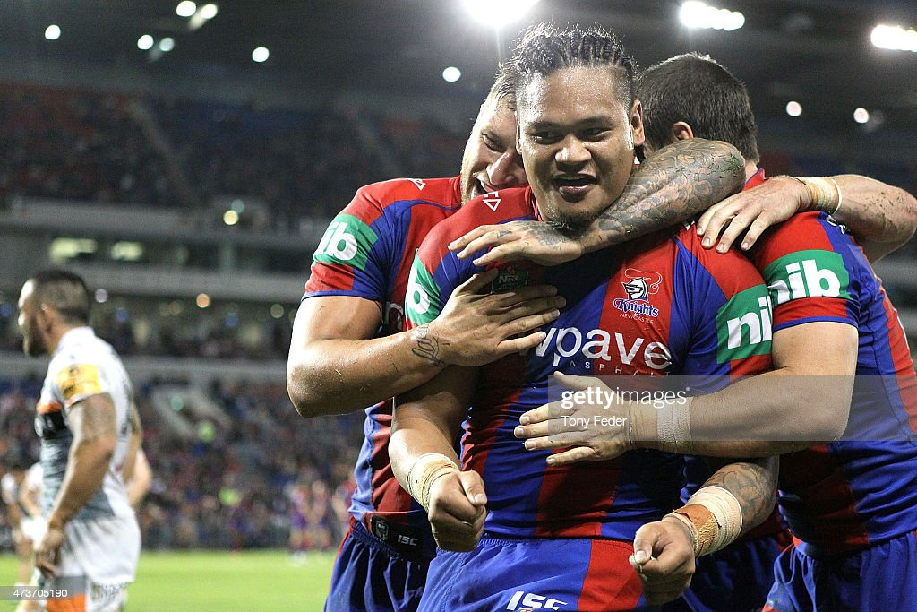 Joey Leilua of the Knights celebrates a try with team mate Tariq Sims during the round 10 NRL match between the Newcastle Knights and the Wests Tigers at Hunter Stadium on May 17, 2015 in Newcastle, Australia.
