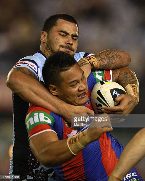 Joey Leilua of the Knights is tackled during the round 22 NRL match between the Cronulla Sharks and the Newcastle Knights at Remondis Stadium on...