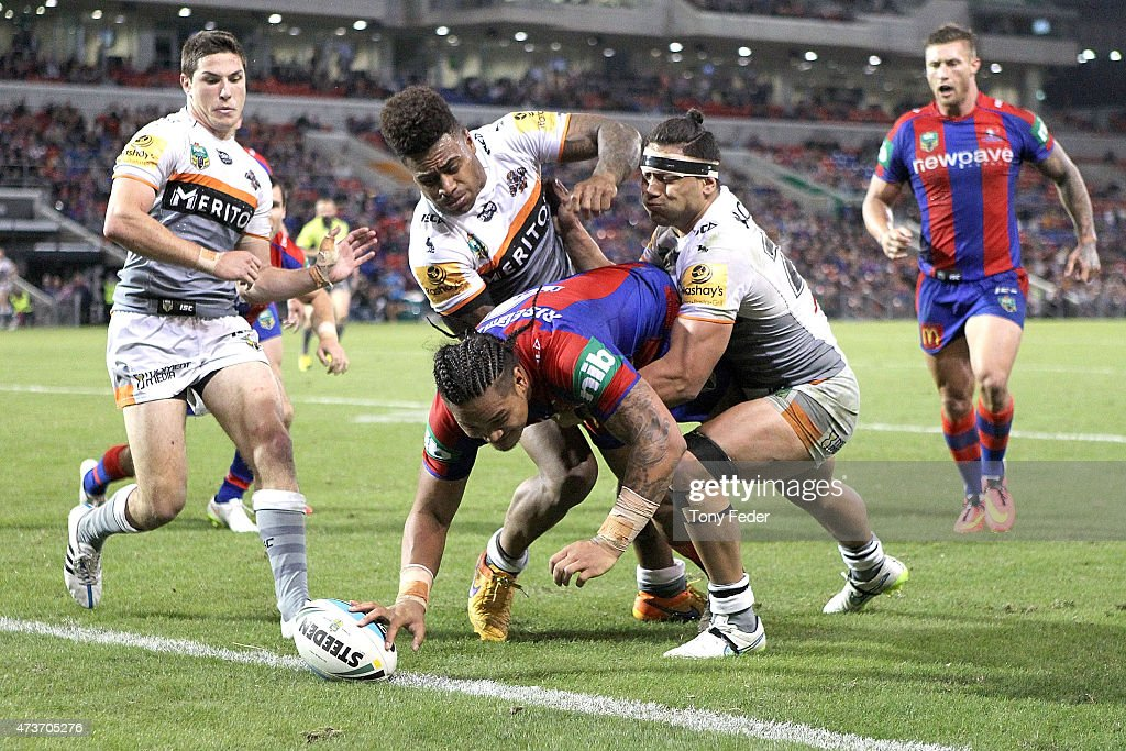 Joey Leilua of the Knights scores a try during the round 10 NRL match between the Newcastle Knights and the Wests Tigers at Hunter Stadium on May 17, 2015 in Newcastle, Australia.