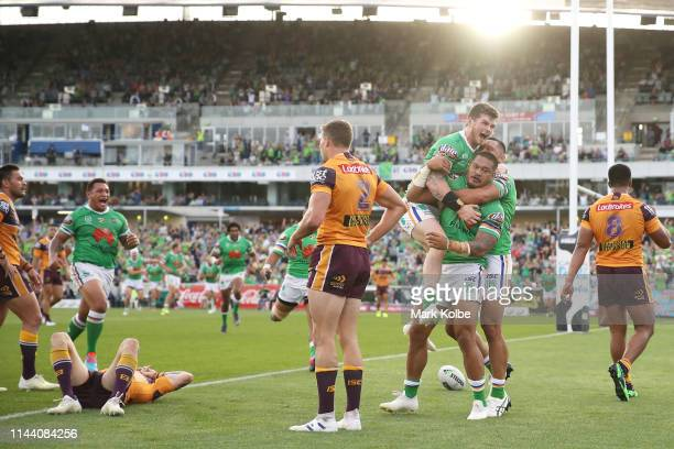 Joey Leilua of the Raiders celebrates with his team mates after scoring a try during the round 6 NRL match between the Canberra Raiders and the...