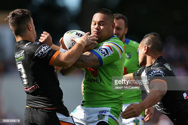 Joey Leilua of the Raiders is tackled during the round 26 NRL match between the Wests Tigers and the Canberra Raiders at Leichhardt Oval on September...