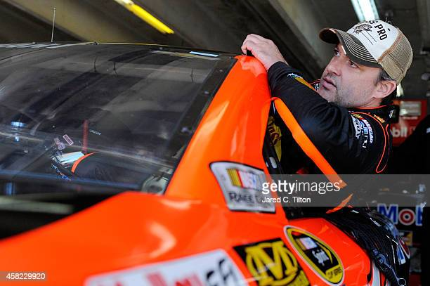 Joey Logano, driver of the AAA Insurance Ford, climbs into his car in the garage area during practice for the NASCAR Sprint Cup Series AAA Texas 500...