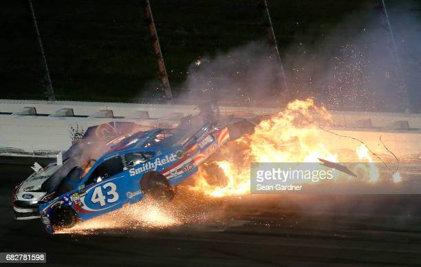 Joey Logano driver of the AAA Insurance Ford Danica Patrick driver of the Wonder Woman/One Cure Ford and Aric Almirola driver of the Smithfield Ford...