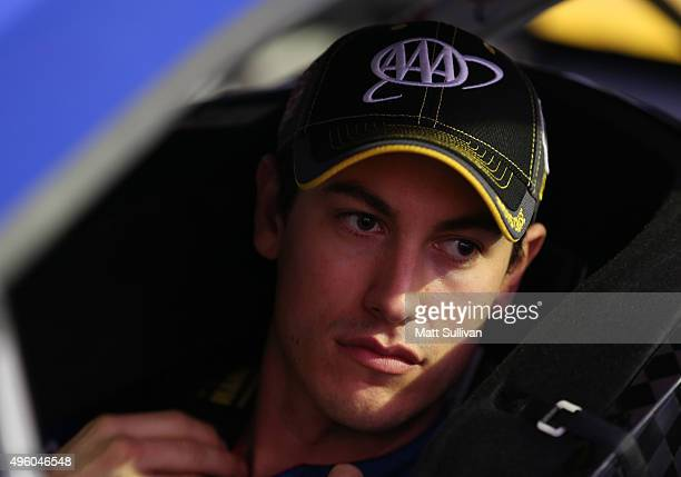 Joey Logano, driver of the AAA Insurance Ford, prepares to drive during Service King qualifying for the NASCAR Sprint Cup Series AAA Texas 500 at...
