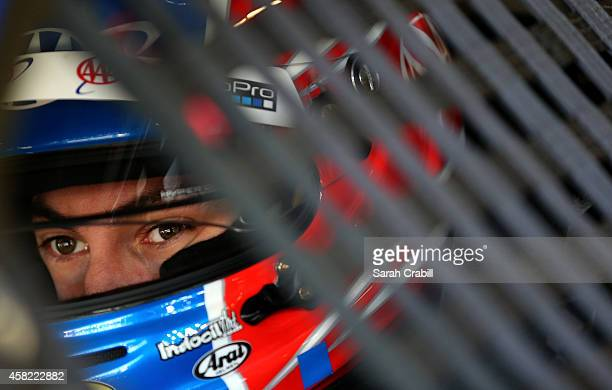 Joey Logano, driver of the AAA Insurance Ford, sits in his car in the garage area during practice for the NASCAR Sprint Cup Series AAA Texas 500 at...