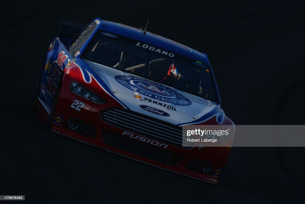 Joey Logano, driver of the #22 AAA Southern California Ford, drives during qualifying for the NASCAR Sprint Cup Series Auto Club 400 at Auto Club Speedway on March 21, 2014 in Fontana, California.